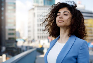 Business woman taking a mindful moment